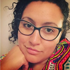 Close up portrait of Aisha Marie Muhammad.