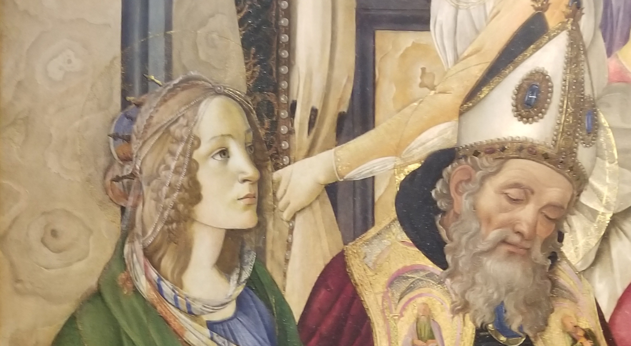 Detail of a Botticelli painting showing the marble wall behind saints